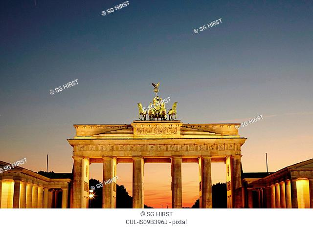 Brandenburg gate illuminated at sunset, Berlin, Germany