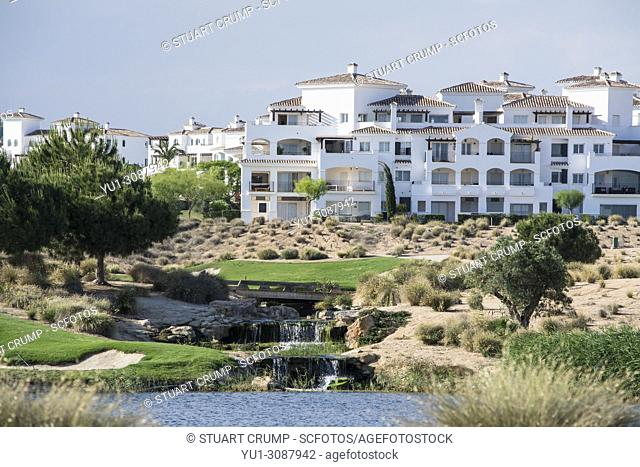 Water hazard with a waterfall feature on the 7th hole at Hacienda Riquelme Golf Resort, Murcia, Spain