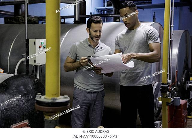 Men working in industrial setting