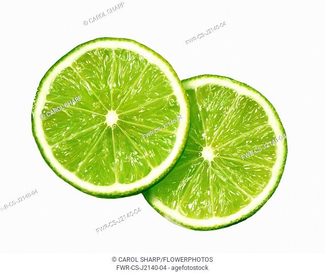 Lime. Citrus aurantiifolia, Plan view of two slices overlapping, cut out on white