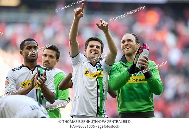 Moenchengladbach's Raffael (L), Jonas Hofmann (C) and goalkeeper Tobias Sippel celebrate after the German Bundesliga soccer match between FCBayern Munich and...