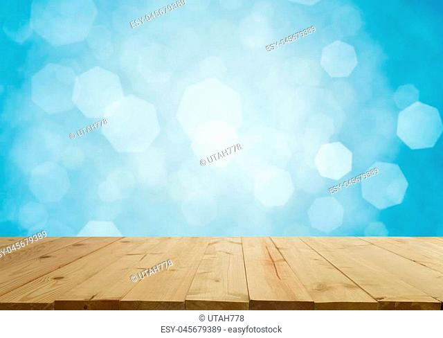 Empty top of wooden table with Abstract of bokeh and natural light of the summer season. For product display and advertising and promotional purposes