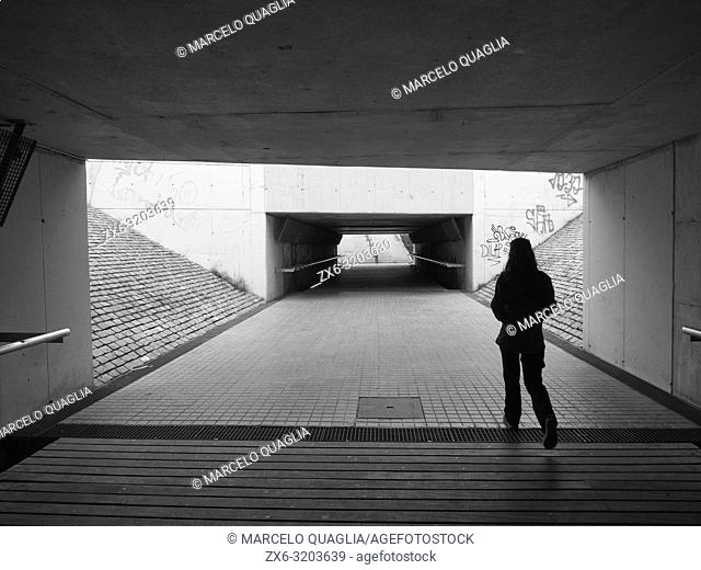 Young woman at railroad underground pathway. Mataro city. Maresme region, Barcelona province, Catalonia, Spain