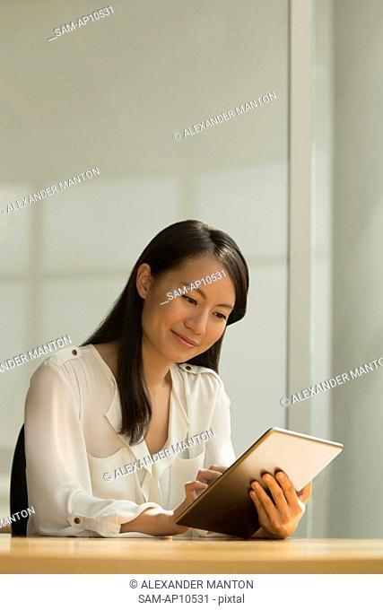 Singapore, Businesswoman using digital tablet