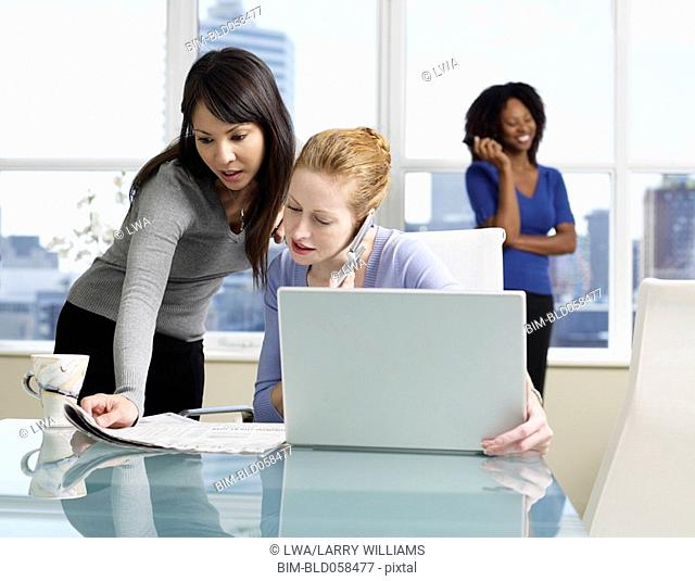 Multi-ethnic businesswomen working in office