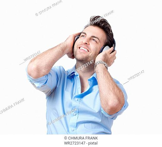 adult, audio, beat, blue, Caucasian, earphones, enjoy, entertainment, expression, face, fun, guy, happy, headphone, headphones, hear, isolated, leisure