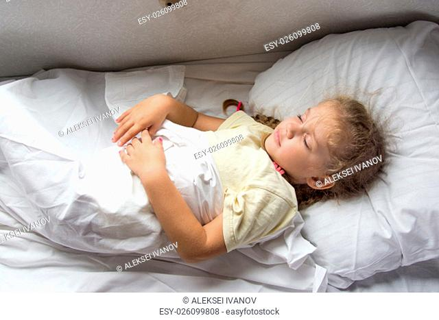 Four-year girl sleeping on a cot in a second-class train carriage