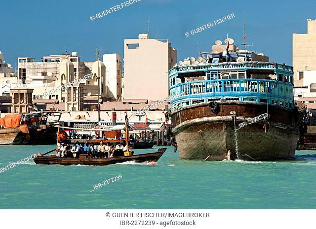 Abra water taxi and cargo ship on the Dubai Creek, Dubai, United Arab Emirates, Middle East