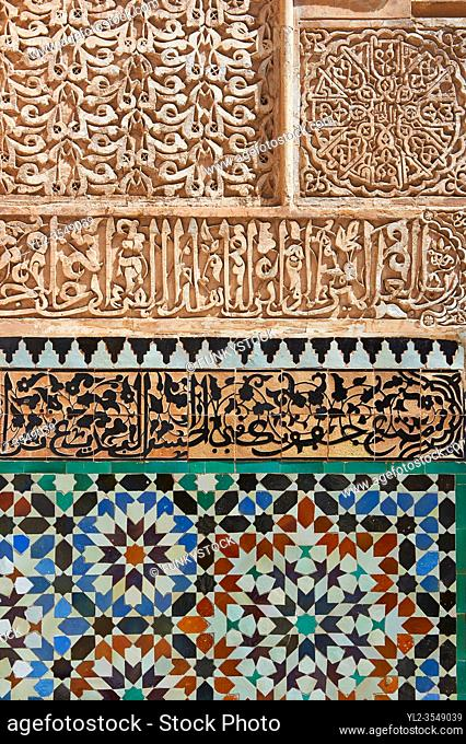 Berber arabesque Morcabe plasterwork and Zellige tiles of the 14th century Ben Youssef Madersa (Islamic college) re-constructed by the Saadian Sultan Abdallah...