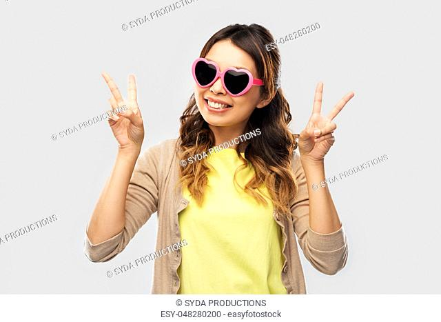 asian woman in heart-shaped sunglasses