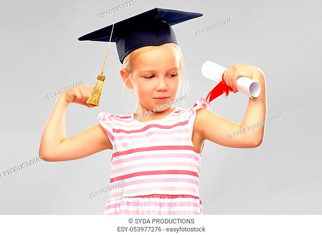 little girl in mortarboard with diploma