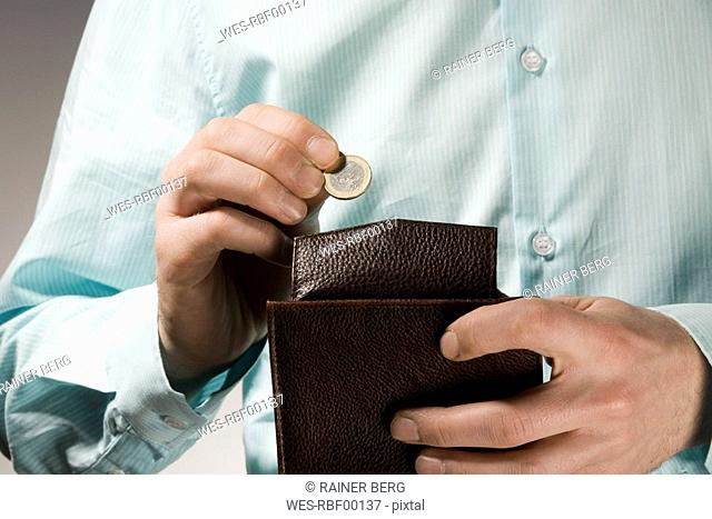 Person holding a wallet, close-up