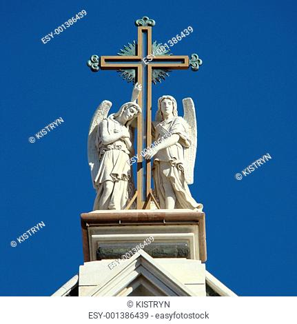 angels holding cross