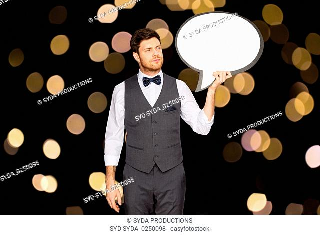 man in suit holding blank text bubble banner
