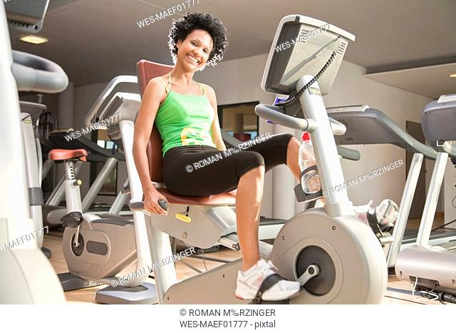 Germany, Bavaria, Woman exercising in gym, portrait
