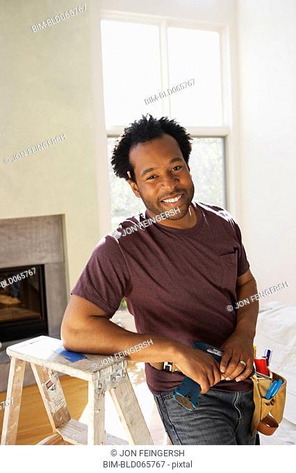 African carpenter in livingroom