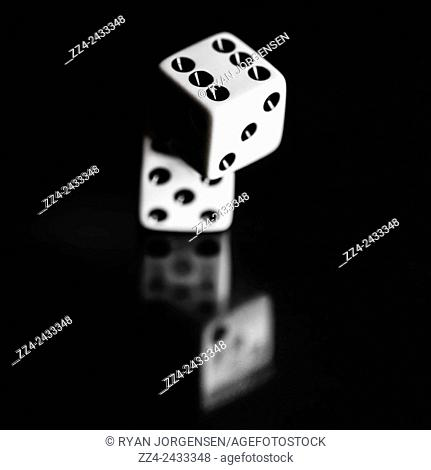 Stacked up odds of probability and loss is at the roll of a dice with the chance of placing the game changing bet, only a gamble away