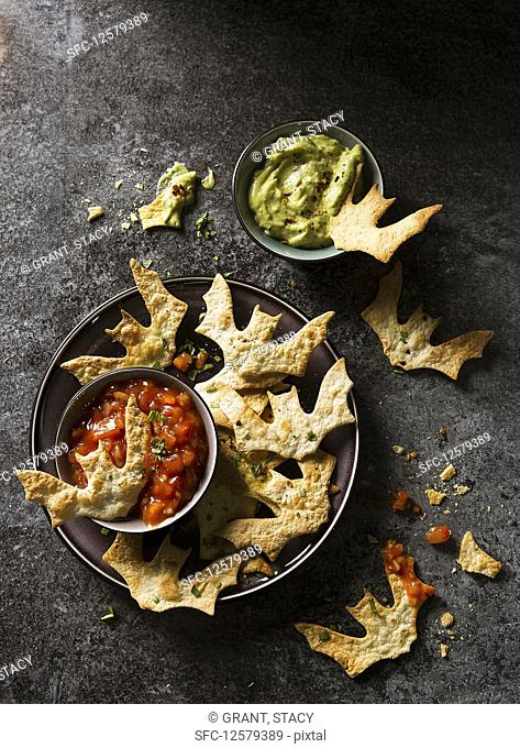 Halloween bat torilla chips with tomato and guacamole dip