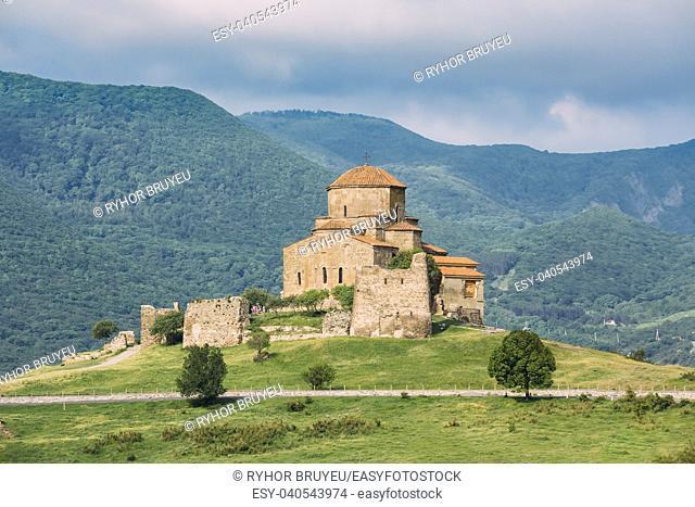 Mtskheta, Georgia. The Scenic View Of Jvari, Georgian Orthodox Monastery, World Heritage By UNESCO. High Mountains Hills Covered With Green Vegetation...