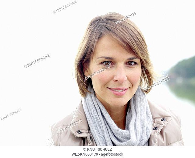 Germany, Munich, Mature woman, smiling, portrait