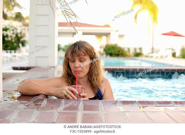 Woman in hot tub at a swimming pool area of a hotel