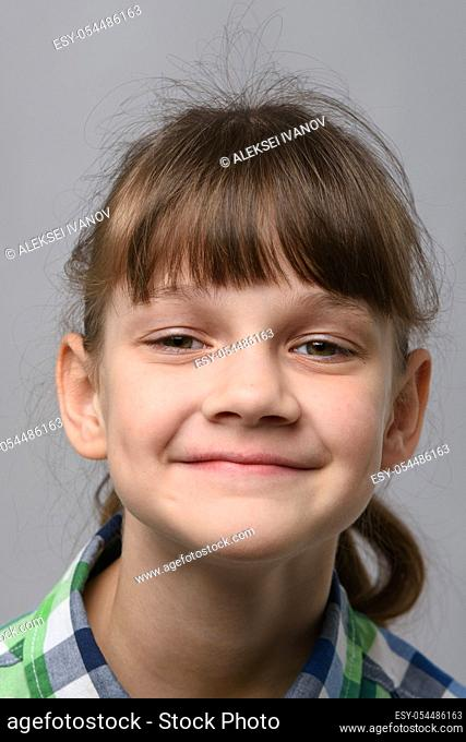 Portrait of a happy ten-year-old girl of European appearance, close-up