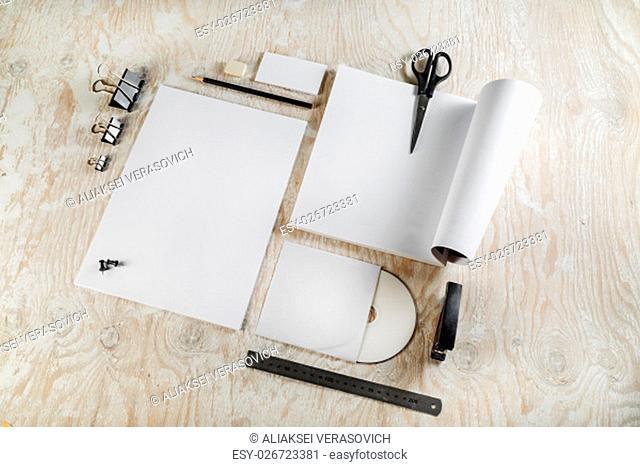 Photo. Blank stationery set on light wooden background. Template for design presentations and portfolios
