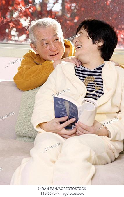 Senior Asian couple looking at each other smiling
