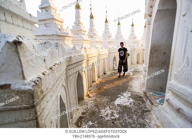 A female tourist walks at Hsinbyume pagoda, Mingun, Sagaing, Myanmar