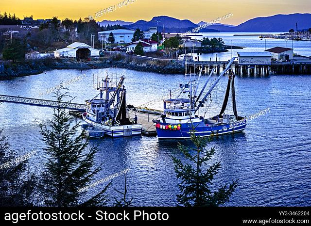 Two commercial fishing purse seiners docked at work platfrom in the harbor of Sitka, Alaska, USA