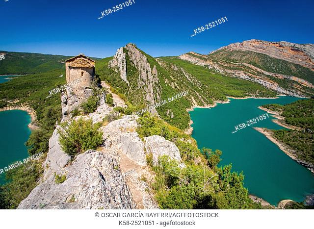 Romanesque hermitage of Mare de Deu de la Pertusa in the way of the gorge Mont-rebei with Canelles reservoir in the bottom of Lleida Montsec