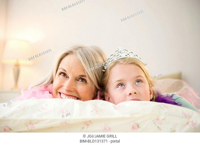 Senior Caucasian woman and granddaughter playing dress up