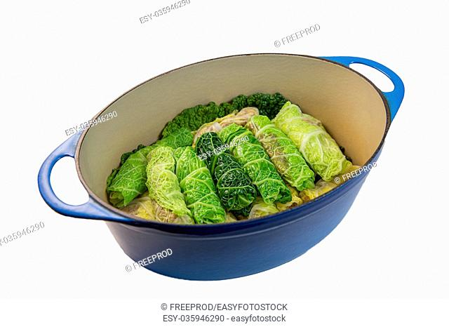 Cabbage stuffed with rice and meat on plate, white background