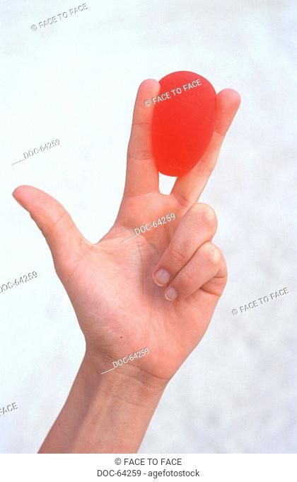 Manual practices with red rubber ball - to hold ball between the fingers