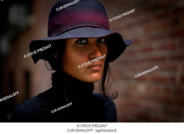 Portrait of beautiful young woman wearing felt hat