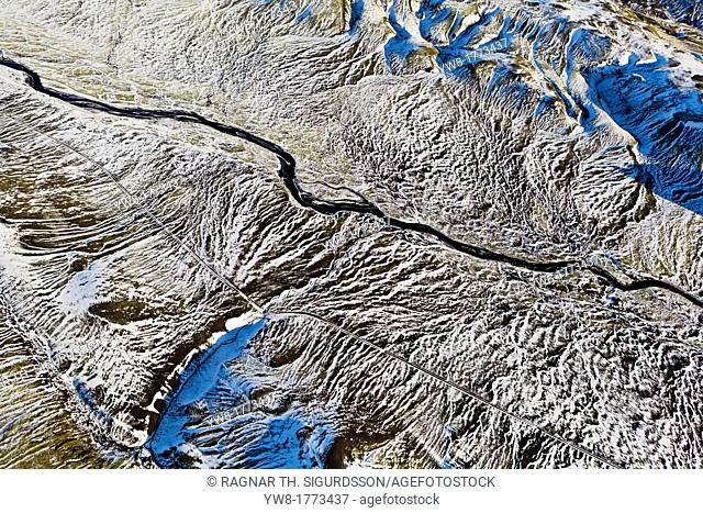 Aerial of riverbed and light covered mountains, Iceland Area near Katla volcano, that is under Myrdalsjokull Ice Cap, Iceland  An eruption is expected