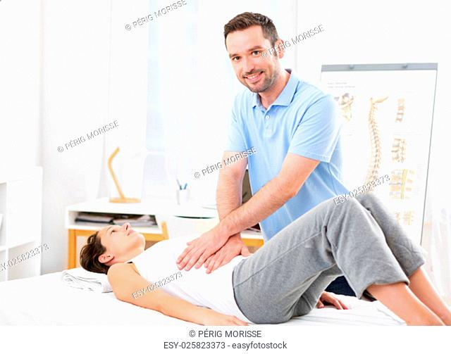 View of an Young attractive woman being manipulated by physiotherapist