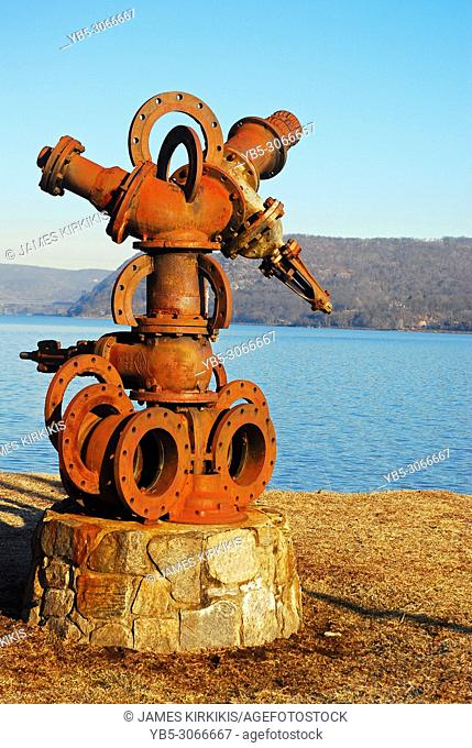 Iron Pump Scuplture stands along the banks of the Hudson River