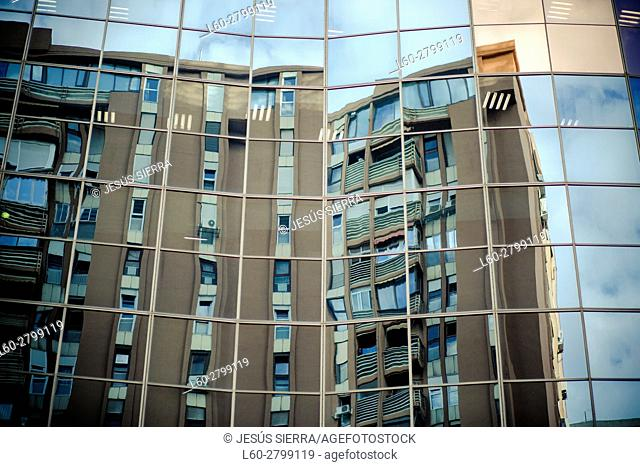 Reflection of a building in Azca financial district in Madrid, Spain