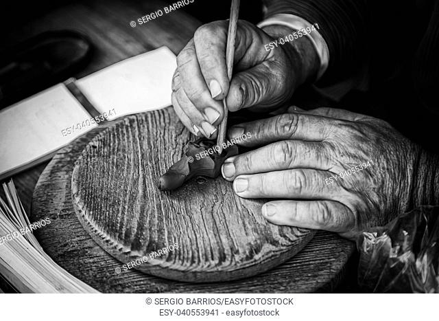 Potter working clay, detail person working, manual labor. Spain