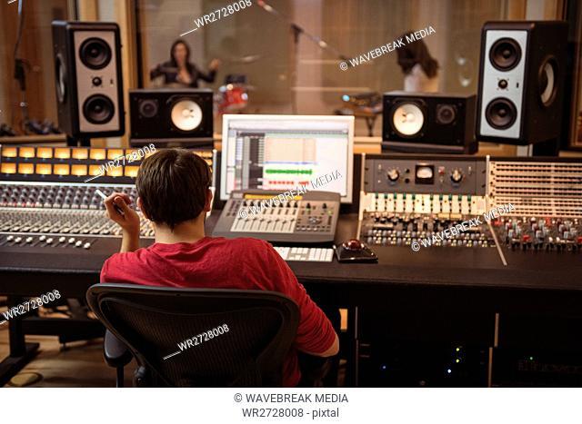 Audio engineer working on sound mixer