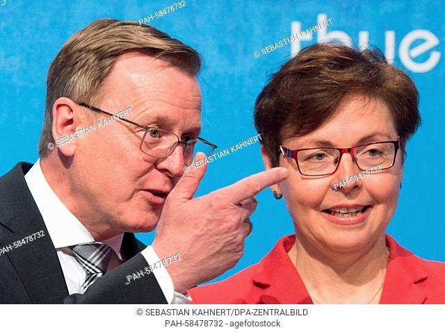 Premier of Thuringia Bodo Ramelow (The Left) and Thuringia's Minister of Finance Heike Taubert (SPD) talk prior to a press conference in Erfurt, Germany