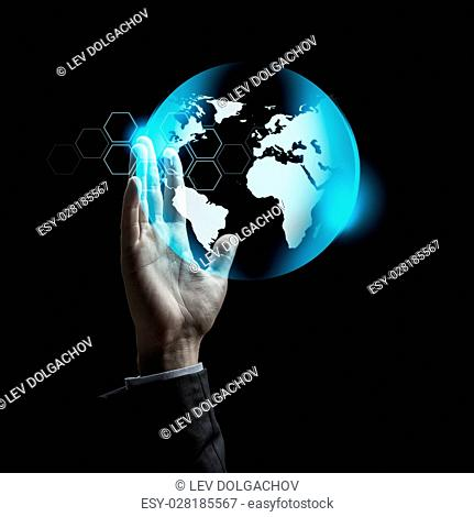 business, people, future technology and mass media concept - close up of raised businessman hand with virtual earth projection over dark background