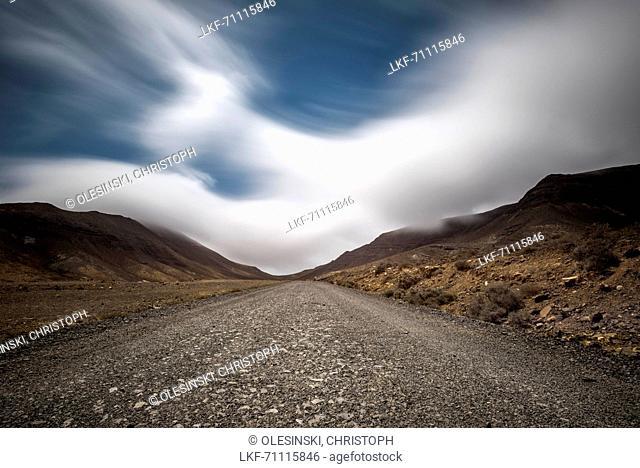 Passat clouds gather over the mountains at the Barranco de las Canarios in Jandia. Barranco de Los Canarios, Jandia, Fuerteventura, Canary Islands, Spain