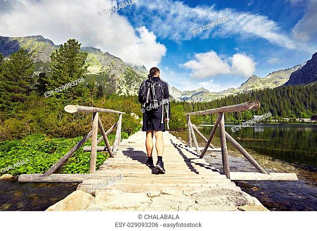 Young man is walking in the mountains