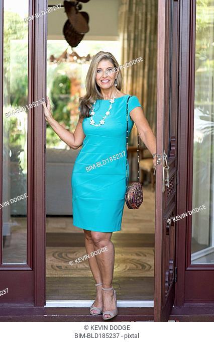Caucasian woman standing in doorway