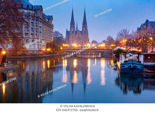 Picturesque landscape with bridge and river Ile embankment in the morning, Strasbourg Cathedral in the background, Strasbourg, Alsace, France