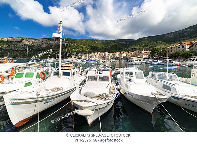 View of Komiza village and its port (Komiza, Vis, Vis Island, Split-Dalmatia county, Dalmatia region, Croatia, Europe)