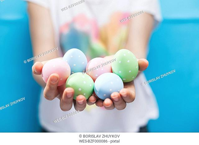 Woman holding Easter eggs