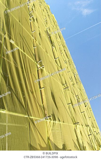 Protective sheeting covering scaffolding, East London, UK
